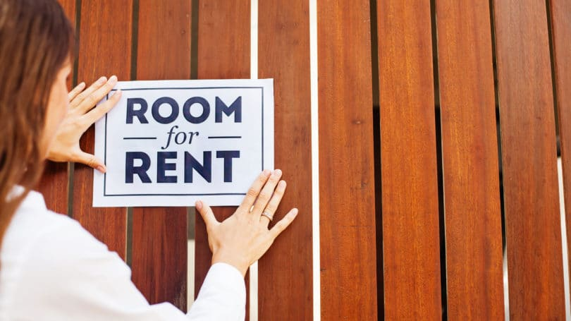 Room For Rent Wooden Fence Woman Sign