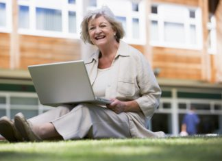 Senior Using Laptop On College Campus Learning Back To School