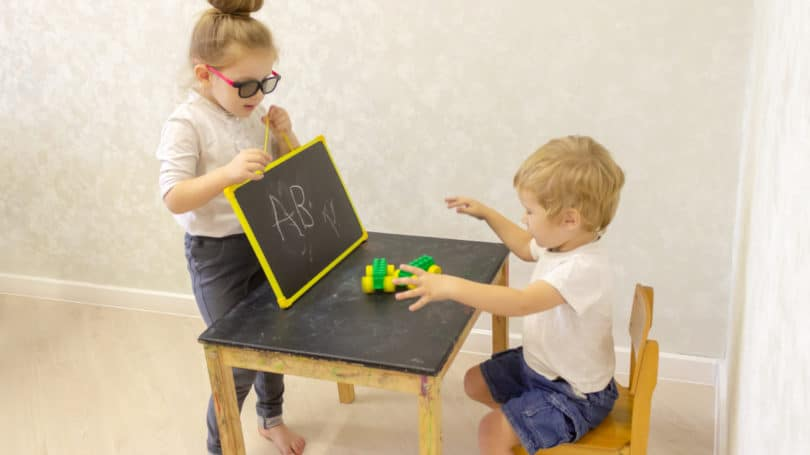 Brother Sister Toddler Playing School Teacher Student