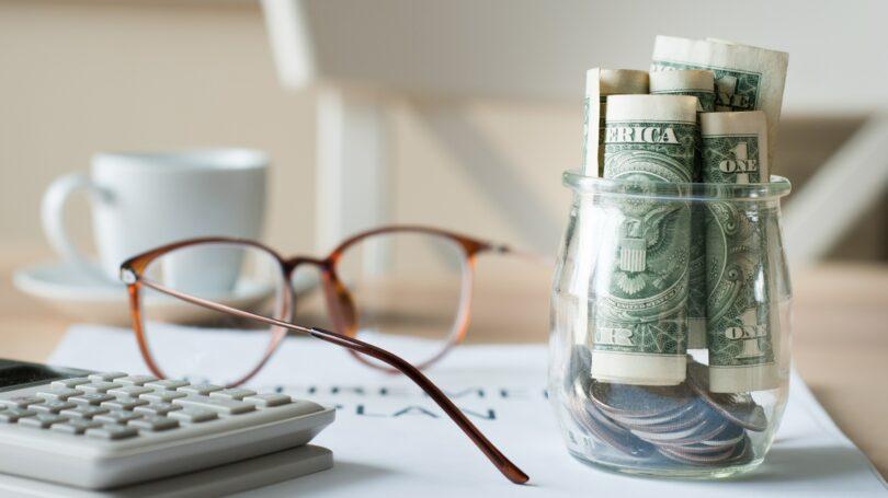 Saving For Retirement Glasses Jar Cash