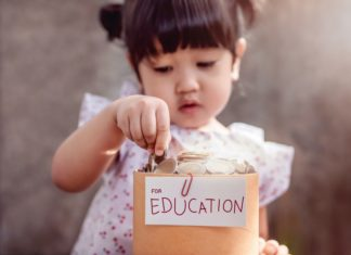 Toddler Girl Saving Money For Education College