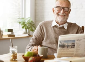 Retirement Senior Citizen Man Elder Reading Newspaper At Home