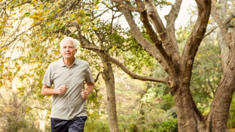Senior Citizen Exercising Elder Running Park Outdoors