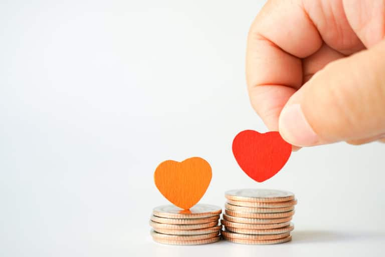Concept Of Hearts Stacked On Coins Love Money