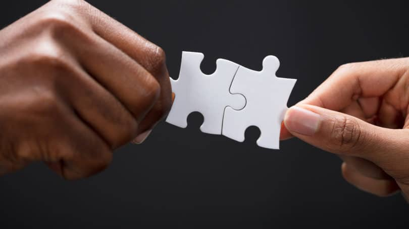 Puzzle Piece Connected Couple Hands