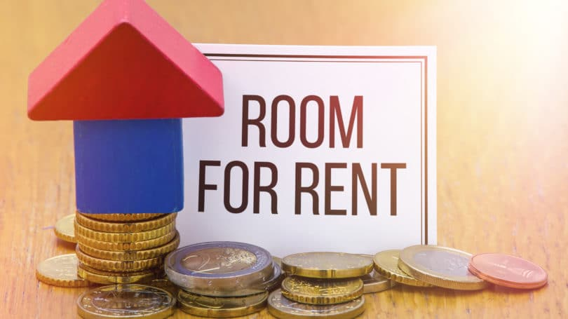 Room For Rent Coins Stacked Sign Blocks House