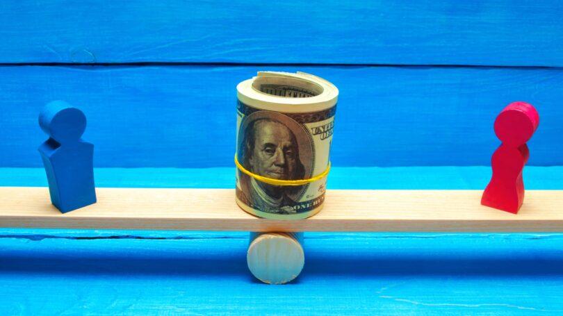 Couple Splitting Money Seesaw Finance Splitting Cost