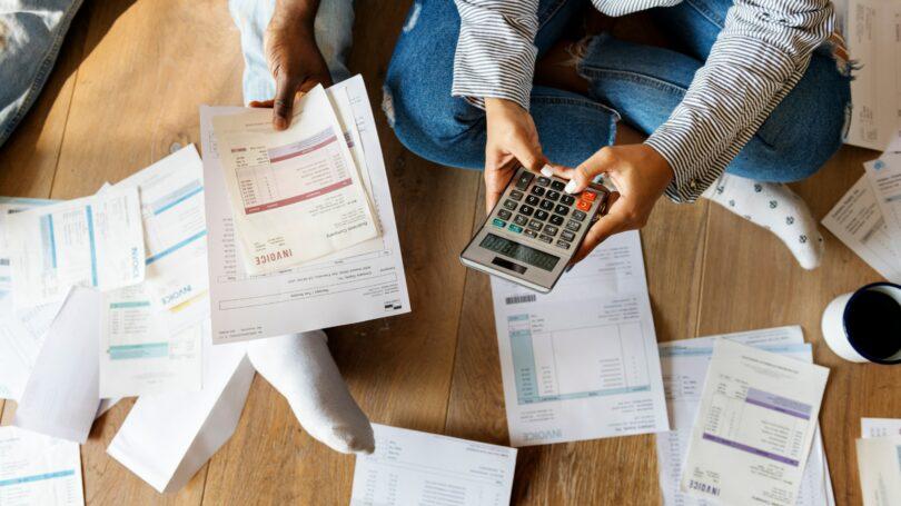 Couple Managing Debt Calculator Finances