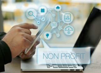 Non Profit Business Organization Phone Laptop Business Strategy Planning