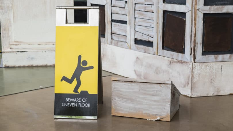 Beware Of Uneven Floors Sign Broken