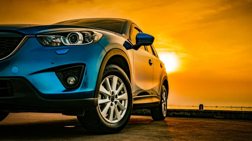 Blue Compact Car Sunset Driving Road