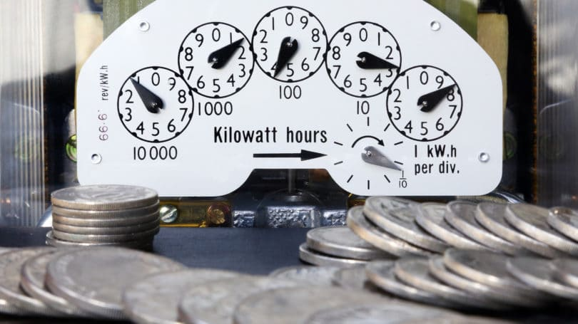 Electric Meter With Money Coins Energy Bill
