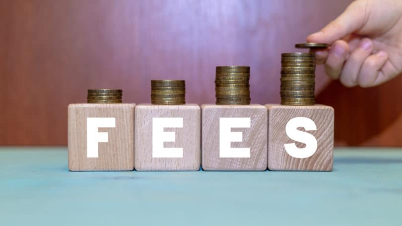 Fees Dice Blocks Letters Coins Stacked