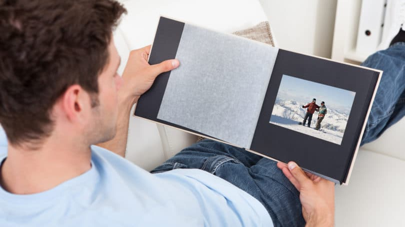 Man Looking Through Photo Album