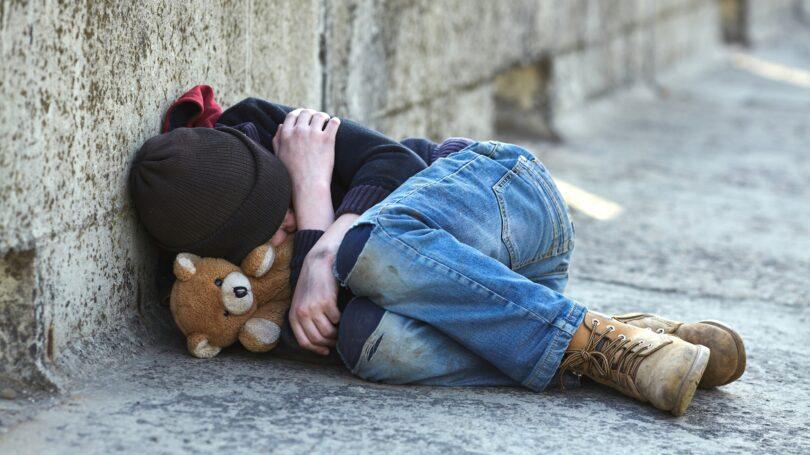 Young Homeless Boy Teddy Bear Sleeping On Street