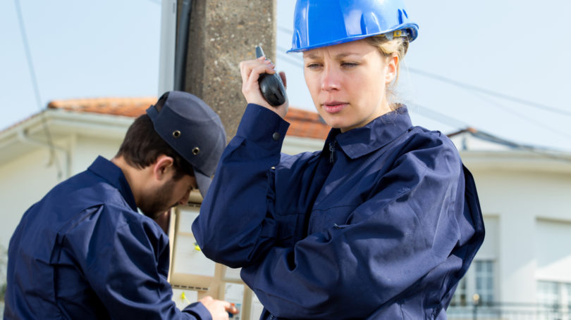 Female Utility Company Employee Walkie Talkie