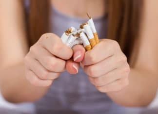Woman Breaking Cigarettes Quit Smoking
