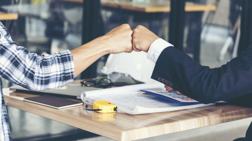 Business Partner Fist Pump Restaurant Table