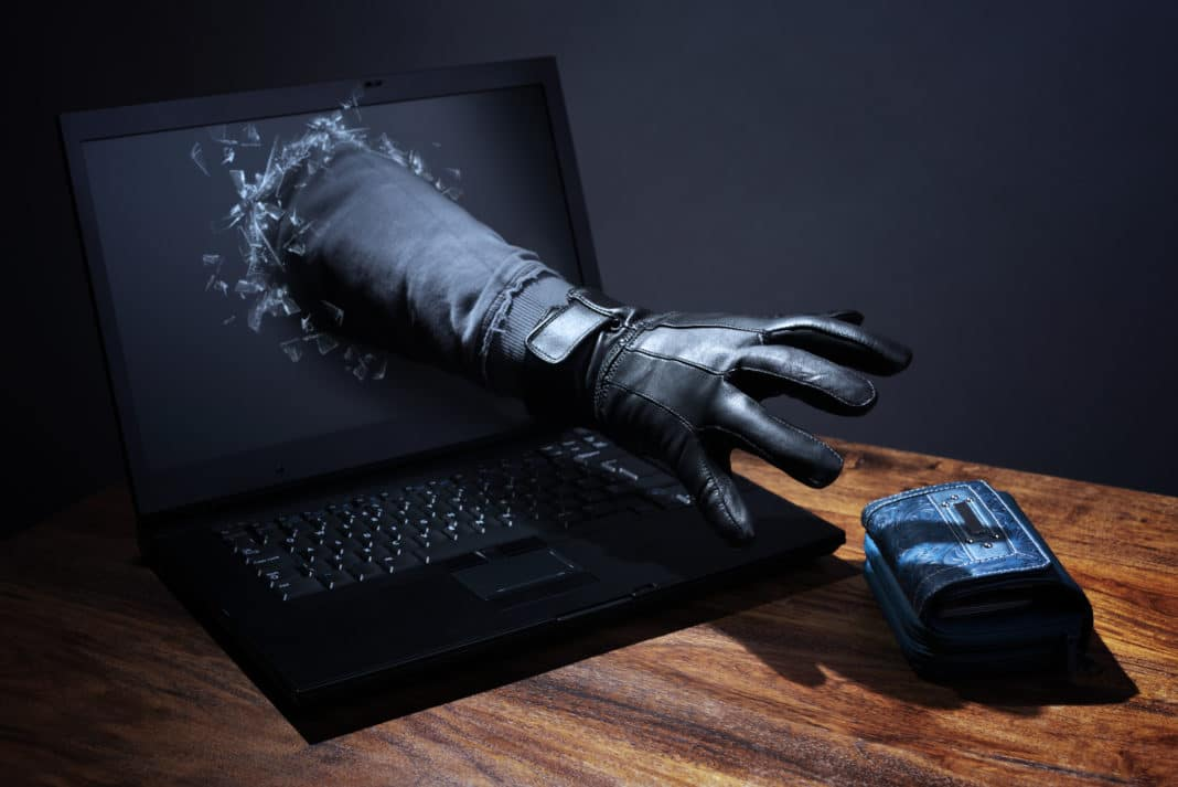 Credit Monitoring Robber Thief Reaching Through Laptop To Steal Hacking Identity Theft