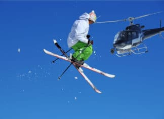 Heli Skiing Jumping In Air Helicopter