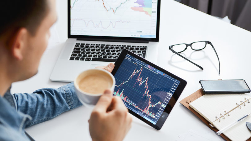 Investor Watching Stock Market Analyzing Fluctuation Tablet