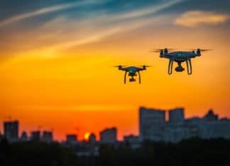 Two Drone Copters Sunset Orange Sky Cityscape