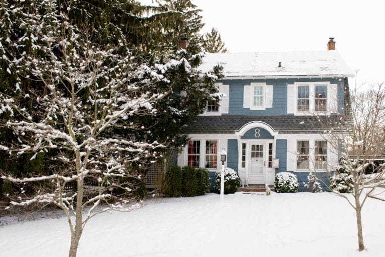 Blue House Snow Covered