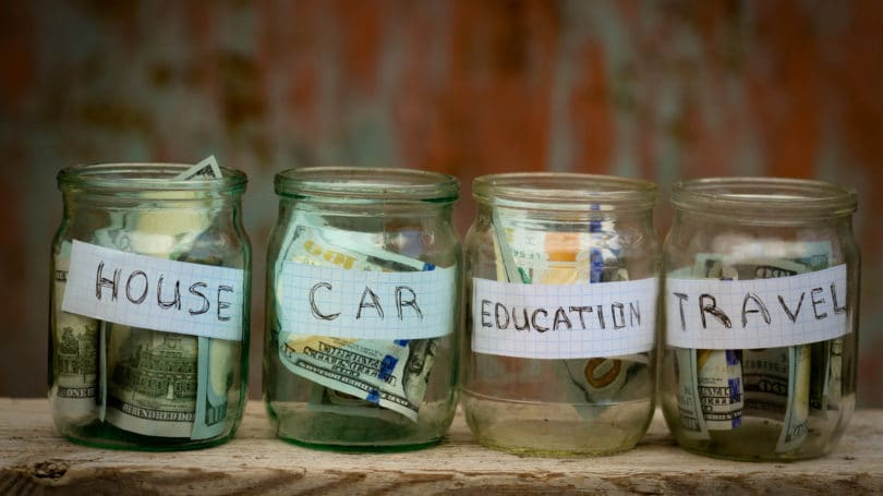 Jars Of Money Savings Funds For House Car Education Travel