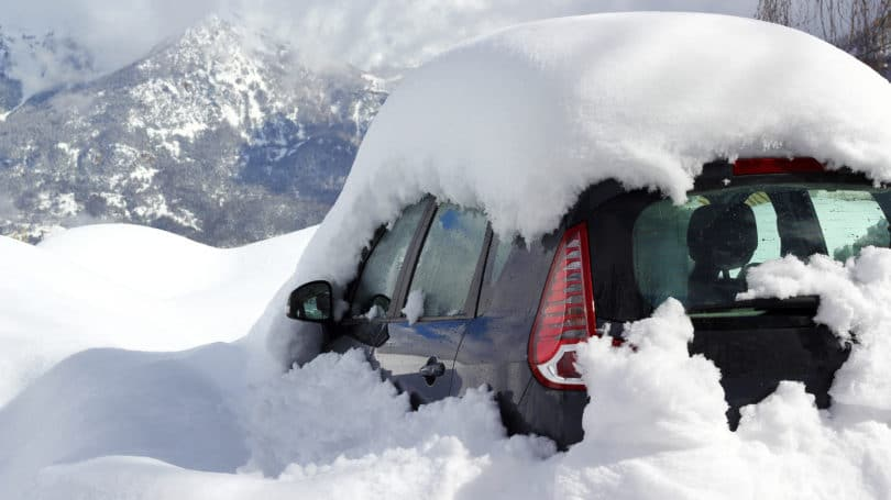 Car Buried Under Snow