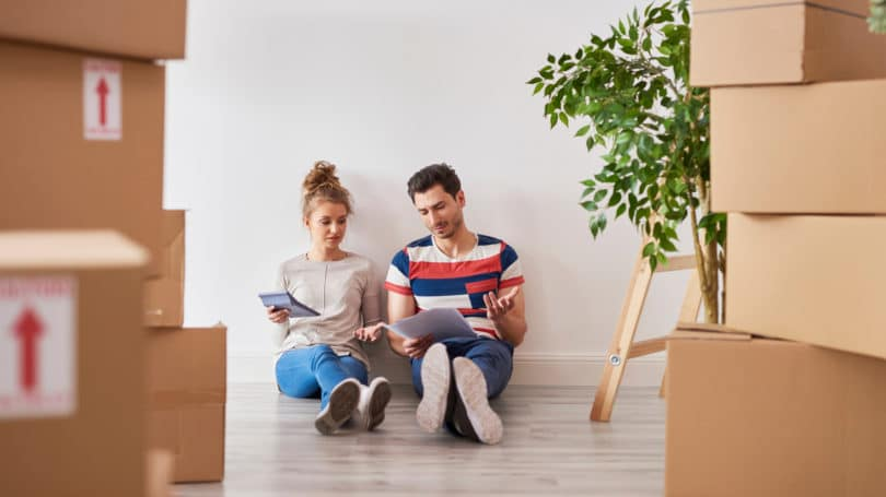 Couple Moving Looking Worried About Bills