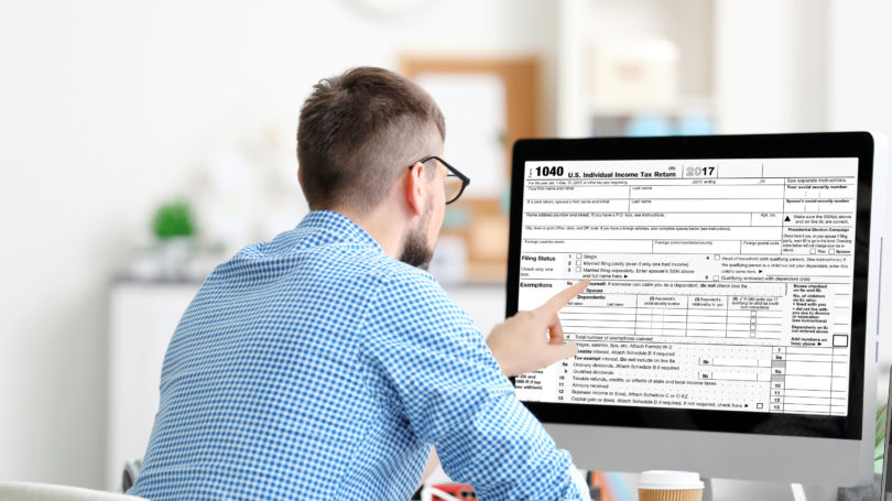 Man Doing Taxes Online Professional Office