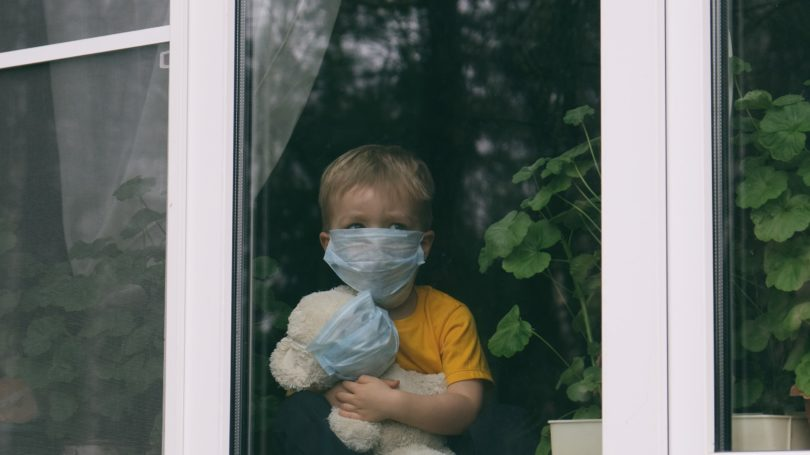 Boy Staying At Home With Mask Teddy Bear Quarantine Pandemic