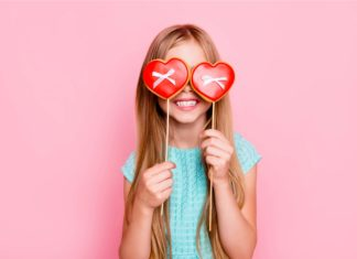 Girl Holding Heart Shaped Dessert Valentines Day