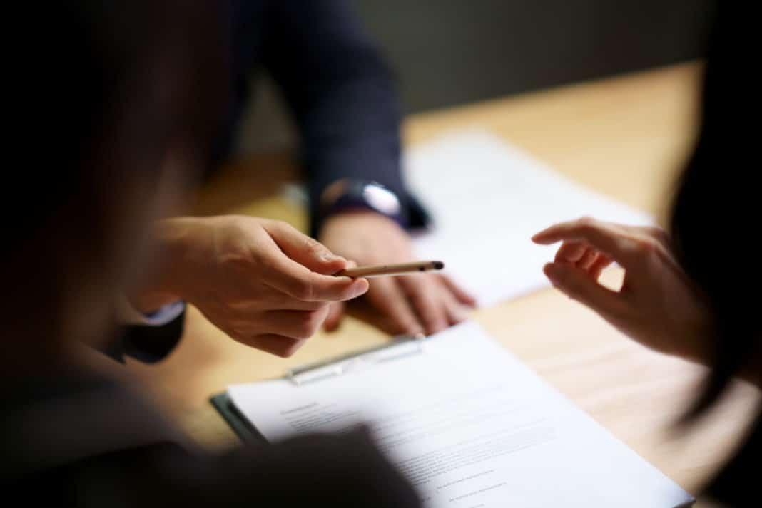 Three People Signing Contract Pen