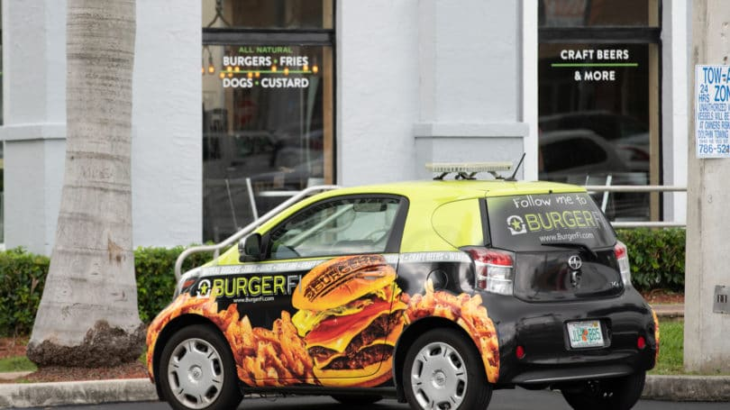 Car Wrapped In Advertising For Burger Restaurant