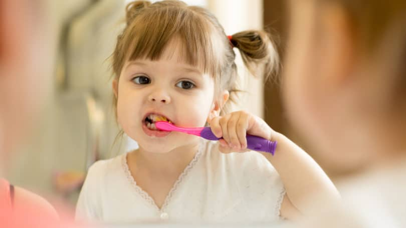 Girl Toddler Brushing Her Teeth Good Morning
