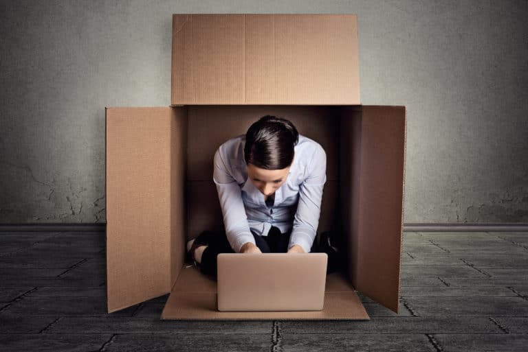 Introvert Woman Hiding In Box Working On Laptop