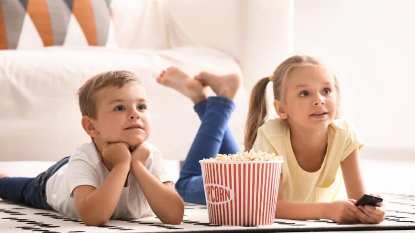 Kids Watching Tv Popcorn On Livingroom Floor Siblings Home