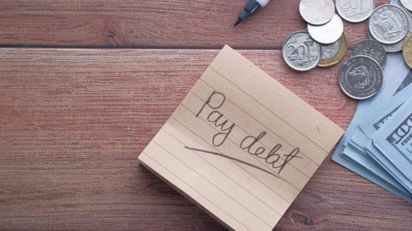 Pay Off Debt Post It Coins Cash