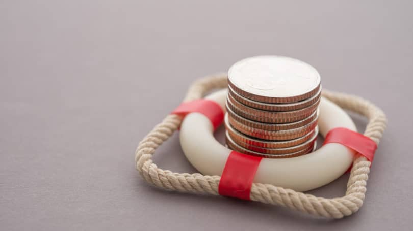 Life Saver Holding Stack Of Coins