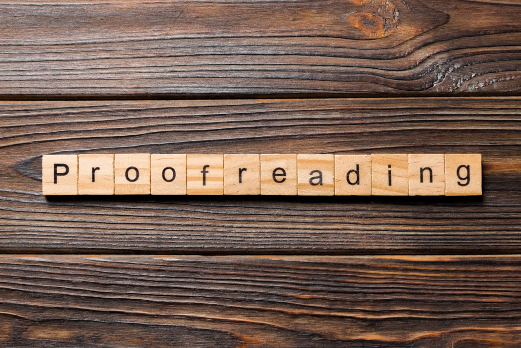 Proofreading Block Letters Wooden Table