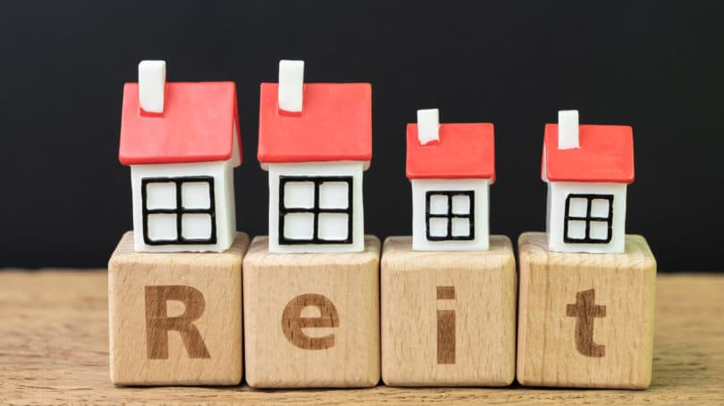 Reit Real Estate Trust Concept On Wooden Blocks
