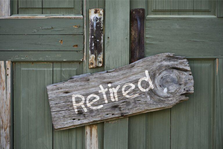 Retired Wooden Sign On Door