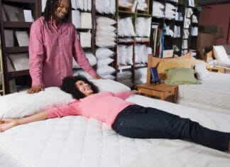 Woman Laying Bed Man Standing