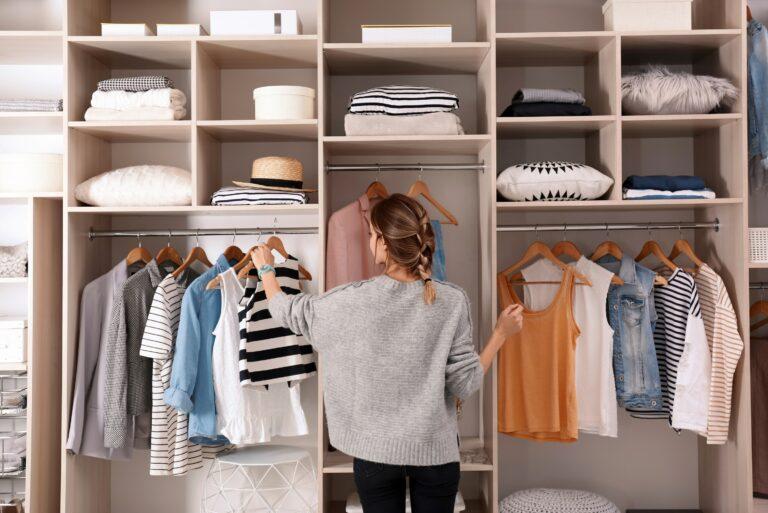 Woman Organizing Her Closet Decluttering Wardrobe