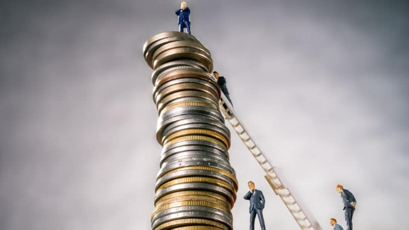 Bankers Climbing Stack Of Coins Ladder