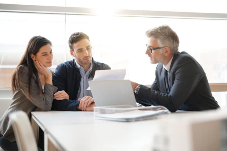 Couple Speaking To Financial Advisor