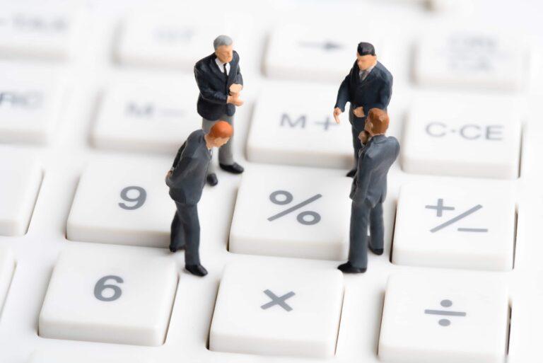 Men Discussing Percentage Sign Interest Tax Calculator