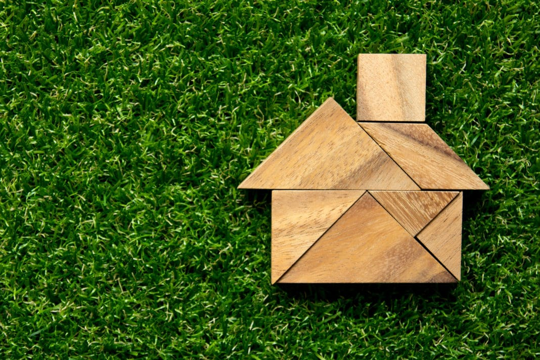 Tangram Puzzle Wooden House On Green Grass