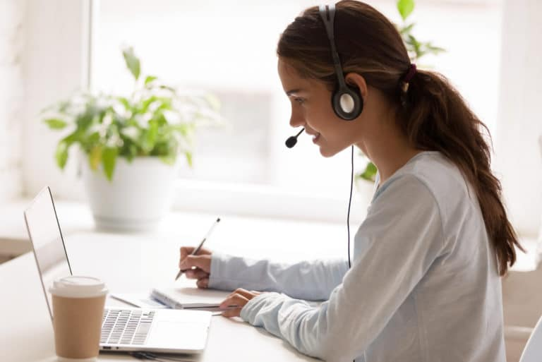 Virtual Assistant Working Headset Taking Notes